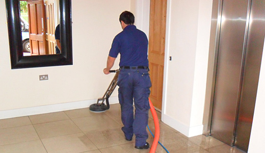 Photo of cleaning operative at work